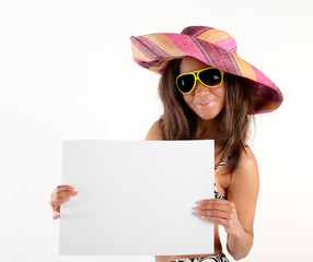 Girl in hat displaying billboard for copy space