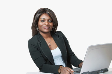 Pretty african woman with laptop