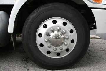 Wheel and tire set under a truck