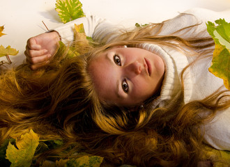 Serious-looking young girl relaxing in autumn