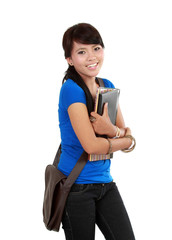 Attractive young student holding books.