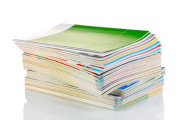Stack of magazines isolated on white
