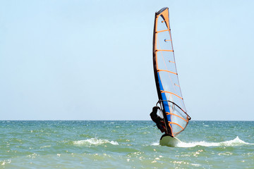 windsurfer on the sea surface