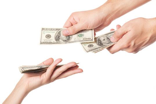 Hands giving money