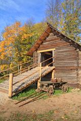 aging cart near wooden barn