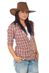 Modern young woman with cowboy hat