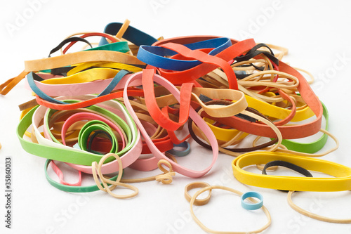 Assortment Of Rubber Bands Piled Against White Background
