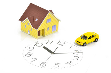 Model house,toy car and clock face