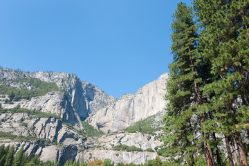 Landscape with mountains, trees and waterfall in Yosemite