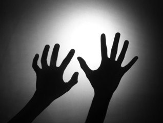 Silhouette of two hands