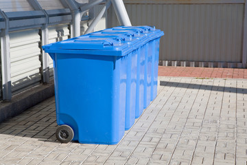 blue plastic recycling bins