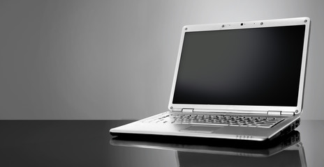 Modern laptop isolated on black background