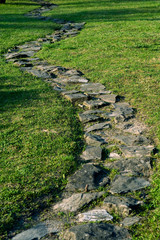 stone footpath on the grass in the garden