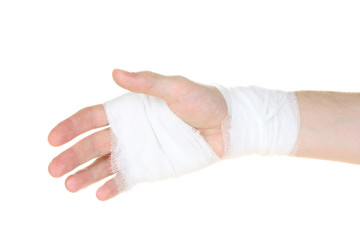 Bandaged hand isolated on white