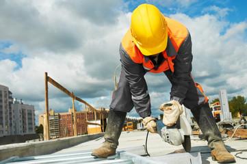 Fototapeta builder working with cutting grinder obraz