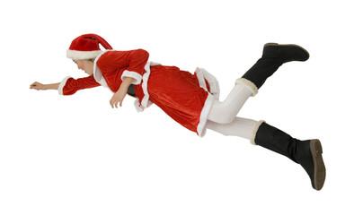 Femme en costume de Noël sautant en l'air