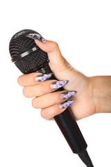 female hand with manicure holds  microphone isolated
