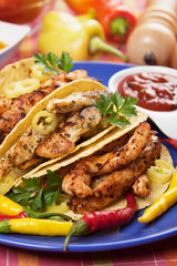 Taco shells filled with chicken meat