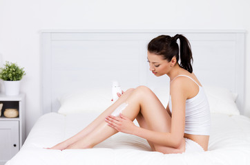 woman caring about her legs with lotion