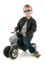 Boy on child's motorcycle