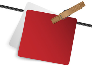 Red paper with clothes peg