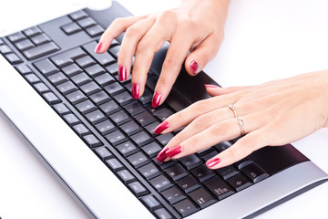 woman hands working on computer keyboard