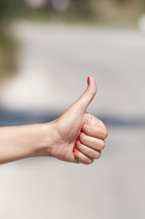 Woman hand hitchhiking