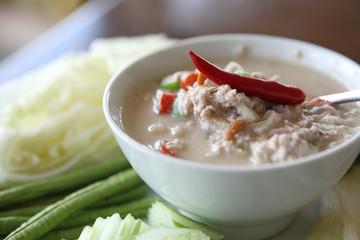 Thai food soya bean dipping sauce in pork with vegetable on woo