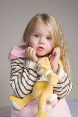Girl with soft toy in the hands