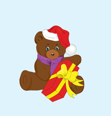 Toy bear with a gift for new year.