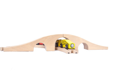 Wooden train set with bridge isolated on white