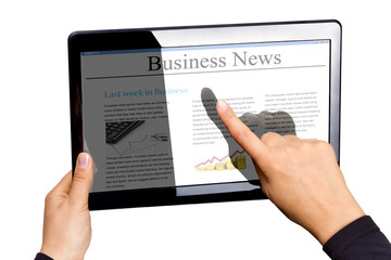 Touchpad with business news isolated on white