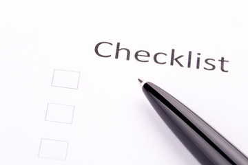 Pen on checklist and three empty squares