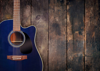Guitar on rustic wood background