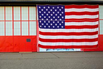 Big American Flag on Industrial Building Facade
