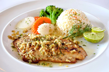 roasted fish served with fried rice