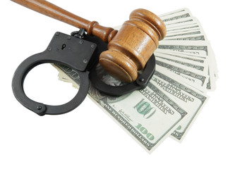 Gavel, handcuffs and money isolated on white