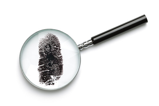 Magnifying glass examining fingerprint