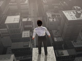 Businessman standing on the skyscraper top