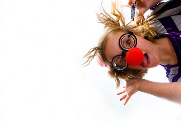 Young girl with a clown nose having fun
