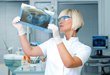 woman dentist with x-ray image