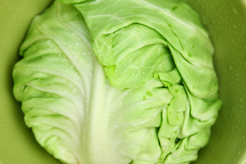 Image of white cabbage in a deep plate closeup