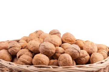 Walnuts in wooden basket on the white background