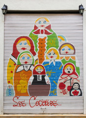painted door with dolls
