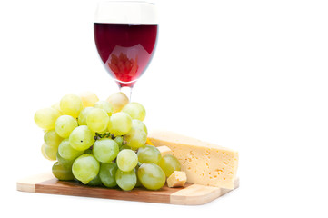 one glass of wine and grapes