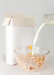 Opened cornflakes box with milk