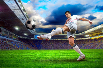 Deurstickers voetbal Football player on field of stadium