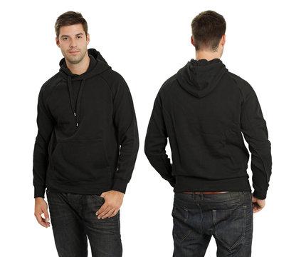 Male wearing blank black hoodie