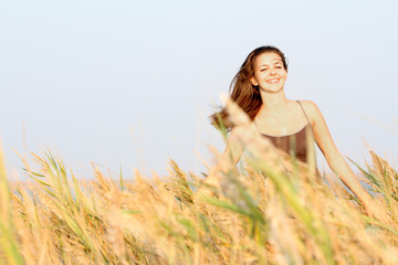 young happy woman in yellow field