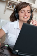 Young business person with headache working at home and calling
